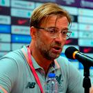 Jurgen Klopp Manager of Liverpool speaks at the post match press conference during the Premier League Asia Trophy match between Liverpool and Crystal Palace at Hong Kong Stadium