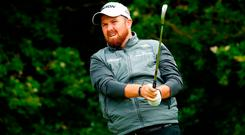 Shane Lowry of Ireland hits his tee shot on the 5th hole