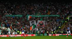 Celtic fans with banners during Linfield match