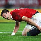 Jonathan Sexton of the Lions falls down injured during the Test match between the New Zealand All Blacks and the British & Irish Lions at Eden Park on July 8, 2017 in Auckland, New Zealand. (Photo by Hannah Peters/Getty Images)