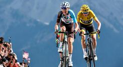France's Romain Bardet leads Chris Froome over the finish line at the Col d'Izoard. Photo: Getty Images