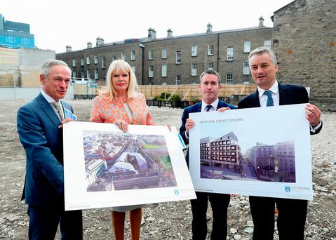 Education Minister Richard Bruton, Junior Minister Mary Mitchell O'Connor, Junior Minister Damien English and Trinity College Provost Patrick Prendergast with plans for the new student accommodation on Pearse Street. Photo: Maxwells