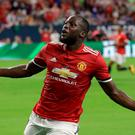Manchester United's Romelu Lukaku reacts to scoring a goal against Manchester City during the first half of an International Champions Cup soccer match in Houston