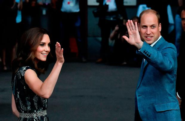 Britain's Princess Kate, the Duchess of Cambridge, and Britain's Prince William, Duke of Cambridge wave to wellwishers as tehy arrive for a reception at 'Claerchens Ballhaus' dance hall in Berlin, on the second day of the British royal couple visit to Germany, on July 20, 2017 in Berlin. / AFP PHOTO / John MACDOUGALLJOHN MACDOUGALL/AFP/Getty Images