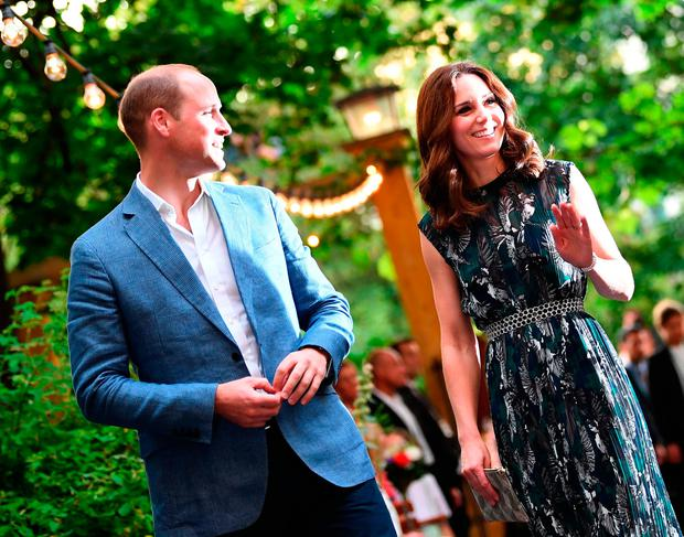 Britain's Princess Kate, the Duchess of Cambridge, and Britain's Prince William, Duke of Cambridge arrive for a reception at 'Claerchens Ballhaus' dance hall in Berlin, on the second day of the British royal couple visit to Germany, on July 20, 2017 in Berlin. / AFP PHOTO / POOL / Britta PedersenBRITTA PEDERSEN/AFP/Getty Images