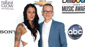LAS VEGAS, NV - MAY 20: Musician Chester Bennington of Linkin Park (R) and wife Talinda Ann Bentley (L) arrive at the 2012 Billboard Music Awards held at the MGM Grand Garden Arena on May 20, 2012 in Las Vegas, Nevada. (Photo by Frazer Harrison/Getty Images for ABC)