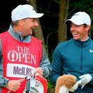 Northern Ireland's Rory McIlroy smiles with his caddie during day two of The Open Championship 2017 at Royal Birkdale