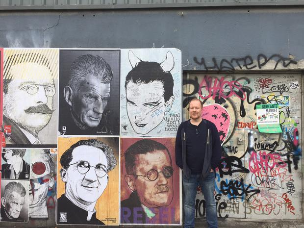 At the wall outside the original Windmill Lane Studio where the band recorded