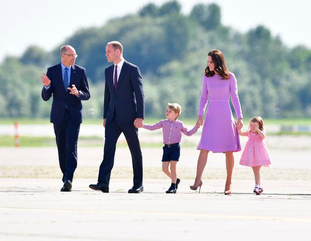 Prince George and Princess Charlotte walk with their parents, the Duke and Duchess of Cambridge, as they visit Airbus in Hamburg, Germany.Photo credit: Dominic Lipinski/PA Wire