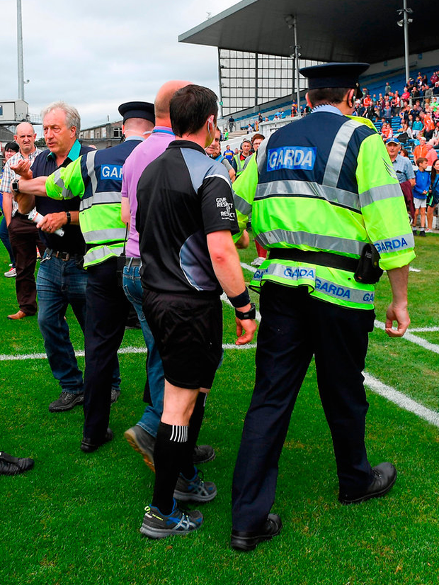 Roscommon referee Paddy Neilan is escorted off the pitch by Gardaí and stadium officials after last Saturday's All-Ireland SFC qualifier between Tipperary and Armagh at Semple Stadium Photo: Ray McManus/Sportsfile