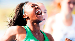 Gina Akpe-Moses crosses the line to win gold in the 100m Photo: Sportsfile