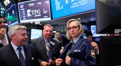 Greta Guggenheim, CEO of TPG RE Finance Trust, Inc., is presented with a traders jacket to celebrate her company's IPO on the floor of the New York Stock Exchange. Photo: Reuters