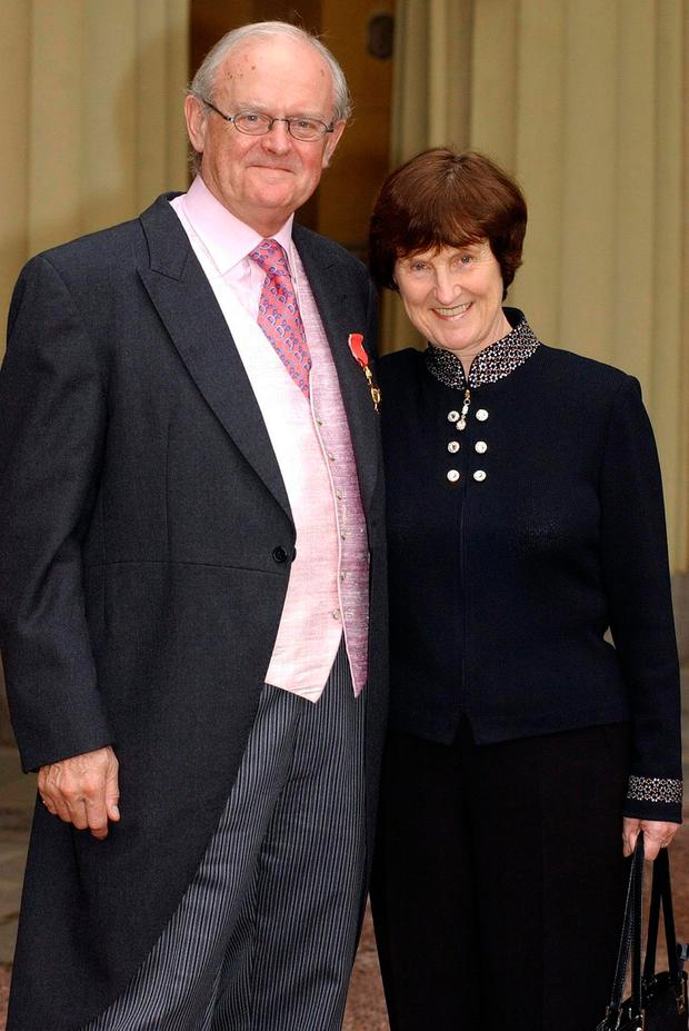 Mavis Arnold with husband Bruce after Bruce received his OBE medal at Buckingham Palace in 2003