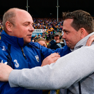 Waterford manager Derek McGrath (left) congratulates then Clare boss Davy Fitzgerald