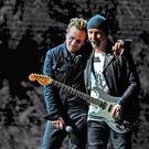 Bono and The Edge on stage in New Jersey on the Joshua Tree Tour. Photos: Nahuel Gutierrez, Getty