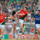 Jason Doherty, Mayo, in action against Aidan O'Mahony, Kerry at the Gaelic Grounds in 2014