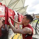 Philippe Coutinho of Liverpool signing autographs at the end of a training session on July 21, 2017 in Hong Kong. (Photo by Andrew Powell/Liverpool FC via Getty Images)