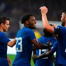 Chelsea's Michy Batshuayi (2L) celebrates with Gary Cahill (R) and Cesar Azpilicueta (L)