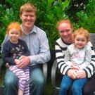 Andrew with his wife Yvonne and their daughters Aoife and Sophie