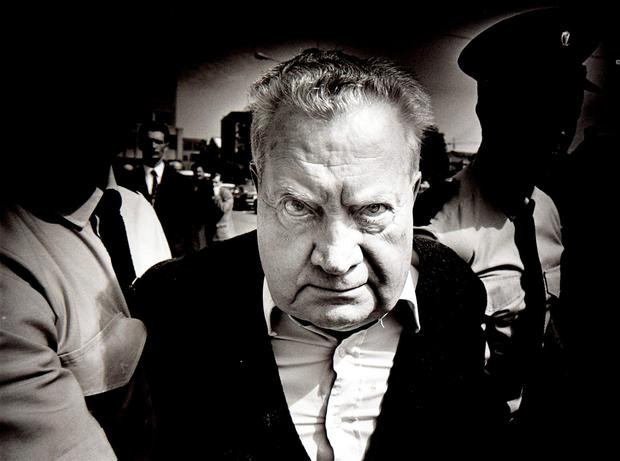 FACE OF EVIL: The iconic photograph by Steve Humphreys of paedophile priest Brendan Smyth being led from the Central Criminal Court 20 years ago. Picture: Steve Humphries