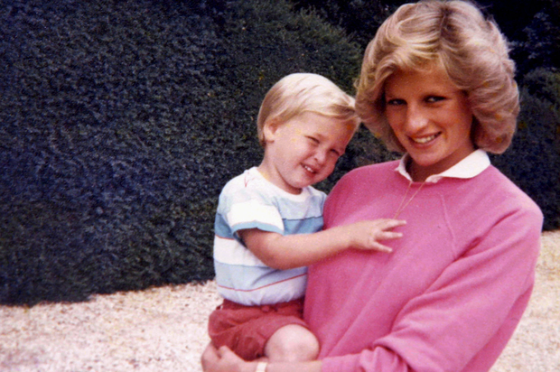 This photograph released by Kensington Palace, from the personal photo album of the late Diana, Princess of Wales, shows the princess holding Prince William whilst pregnant with Prince Harry, and features in the new ITV documentary 'Diana, Our Mother: Her Life and Legacy', which airs on ITV at 21.00hrs on Monday 24th July. The Duke of Cambridge and Prince Harry.