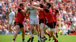 Sean Cavanagh of Tyrone in action against Darren O'Hagan, Gerard McGovern and Kevin McKernan of Down