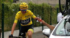 Chris Froome of Great Britain and Team Sky toasts a glass of champagne with his team during stage twenty one of Le Tour de France 2017 on July 23, 2017 in Paris, France. (Photo by Chris Graythen/Getty Images)
