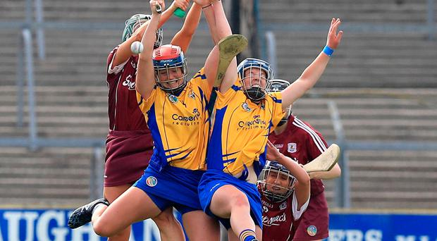 The battle is fierce under the dropping ball between Clare and Tipperary. Photo: DONALL FARMER/INPHO