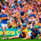 Shane O'Donnell of Clare battles for possession with Tipperary's James Barry. Photo: Ray McManus/Sportsfile