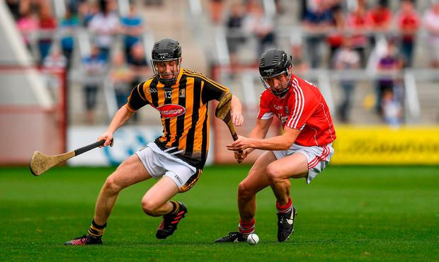 Cork's Shane Hegarty and Sean Carey of Kilkenny battle for possession. Photo: Ray McManus/Sportsfile