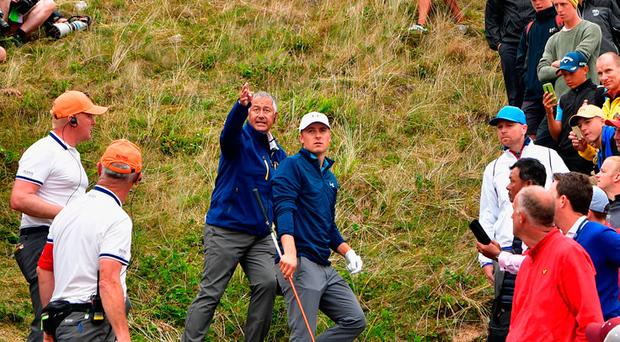 Jordan Spieth finds himself 100 yards off the fairway at the 13th Photo: Getty
