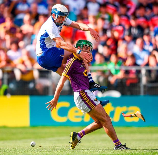 Waterford's Stephen Bennett in action against Shaun Murphy of Wexford during yesterday's quarter-final in Páirc Uí Chaoimh. Photo: STEPHEN McCARTHY/SPORTSFILE