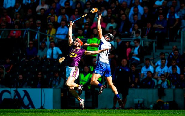 Diarmuid O'Keeffe and Darragh Fives battle for possession. Photo: Ray McManus/Sportsfile