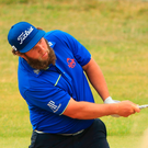 Andrew 'Beef' Johnston hits a shot out of the bunker during yesterday's final round Photo: Getty