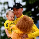 Tour de France winner Chris Froome celebrates his victory with his son Kellan in Paris yesterday Photo: AFP/Getty
