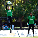 David De Gea catches the ball during training under the watchful eye of Sergio Romero Photo: Getty