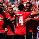 Manchester United forward Anthony Martial (right) celebrates with midfielder Jesse Lingard after Lingard scored a goal during the first half of the International Champions Cup match in Santa Clara, California.
