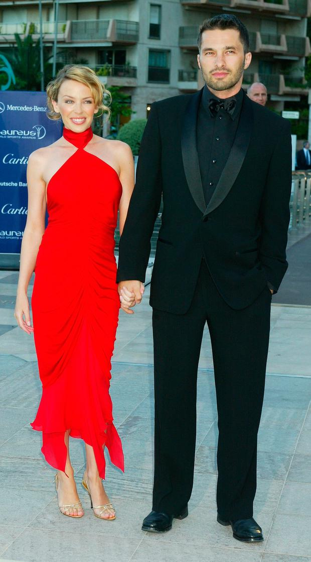 Singer Kylie Minogue and boyfriend, actor Olivier Martinez, attend the Laureus World Sports Awards at the Grimaldi Forum May 20, 2003 in Monaco. (Photo by Pascal Le Segretain/Laureus via Getty Images)