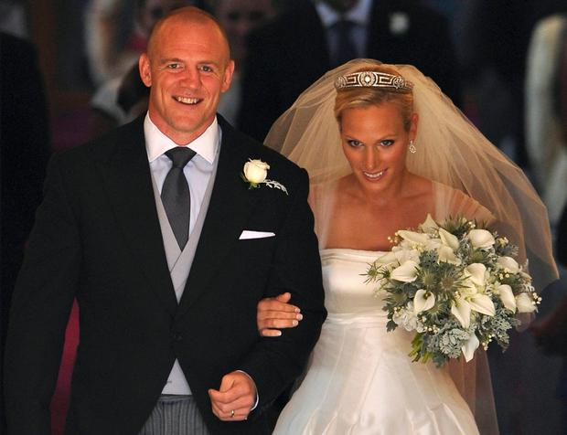 England rugby player Mike Tindall (L) and his new wife Britain's Zara Phillips, granddaughter of Queen Elizabeth II, leave after their wedding ceremony at Canongate Kirk in Edinburgh, Scotland, on July 30, 2011. AFP PHOTO / DYLAN MARTINEZ/POOL