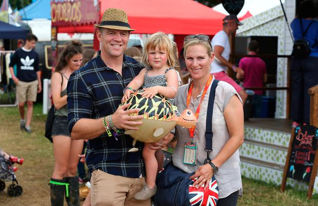 Mike Tindall, Zara Tindell and their daughter Mia Tindall pose for a photograph during day three of The Big Feastival at Alex James' Farm on August 28, 2016 in Kingham, Oxfordshire. (Photo by Tim P. Whitby/Getty Images)