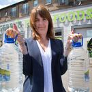 Martina Higgins, Manager, Gerrys Supermarket, Bryanstown, Drogheda pictured with supplies of water. PIC COLIN O'RIORDAN