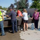 Council Workers pictured filling bottles with water for residents at Ballsgrove, Drogheda yesterday. PIC COLIN O'RIORDAN
