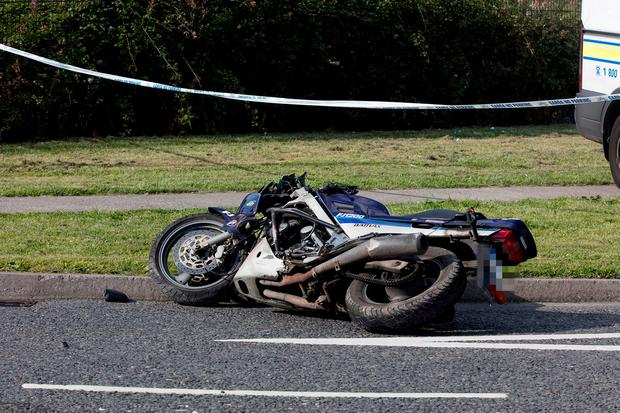 Gardai investigate a road traffic accident involving a motorcyclist and his passenger at Clare Hall in Dublin. Picture: Arthur Carron