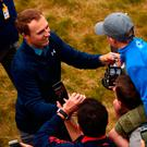Jordan Spieth celebrates his Open victory with a young supporter at Birkdale on Sunday. Photo by Dan Mullan/Getty Images