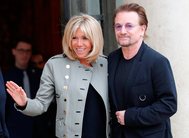 Bono pictured with Brigitte Macron, wife of the French President, at the Elysee Palace in Paris. Photo: REUTERS/Philippe Wojazer