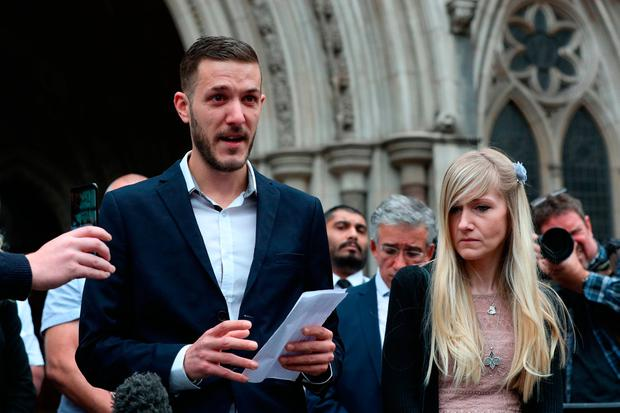 Charlie Gard's parents Chris Gard and Connie Yates speak to the media outside the High Court in London after they ended their legal fight over treatment for the terminally ill baby