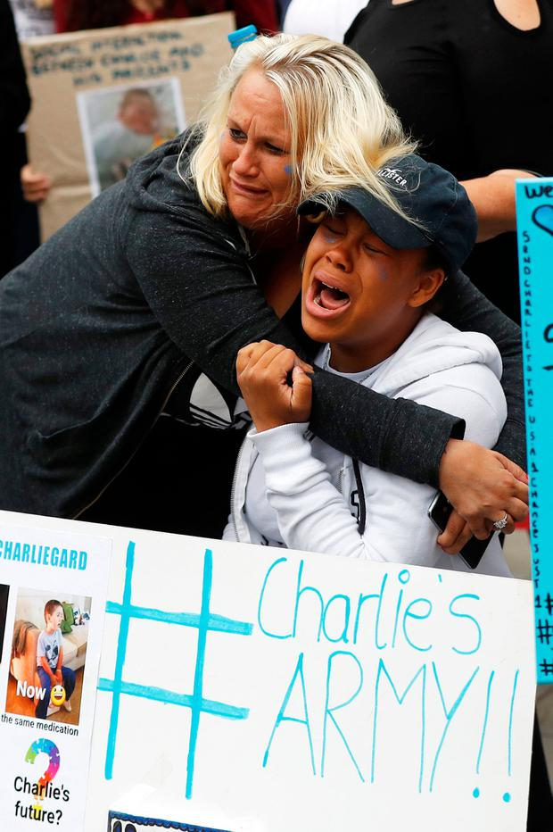 Supporters of the Charlie Gard campaign cry outside court after the parents made the decision about their little boy. Photo: REUTERS/Peter Nicholls