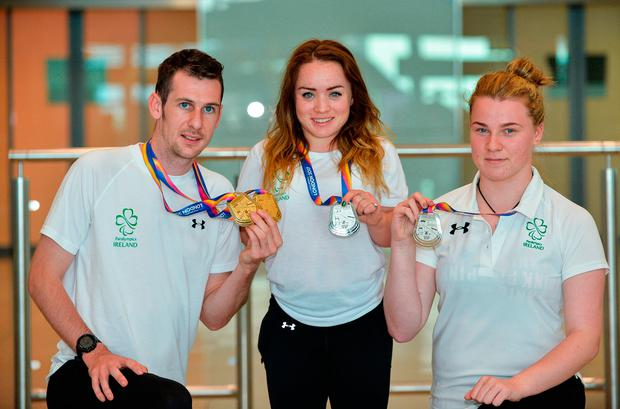 Team Ireland athletes Michael McKillop, who won gold in both the T38 800m and T37 1500m, Niamh McCarthy, who won silver in the F41 Discus, and Noelle Lenihan, who won silver in the F38 Discus, arrive home to Dublin Airport. Photo: Sam Barnes/Sportsfile