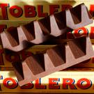 Shrinking feeling: 150g and 170g bars of Toblerone chocolate. Photo: Reuters/Darren Staples