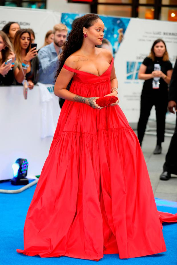Rihanna takes the plunge in dramatic red gown at London premiere ...